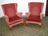 Pair of wing back fireside chairs.