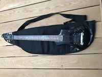 Lindo electric travel guitar (plus padded case, pocket amp and stereo headphones)