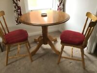 Round drop leave table with matching chairs