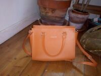 Lancaster orange leather handbag