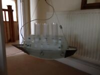 Child's glass light fitting shaped as a ship
