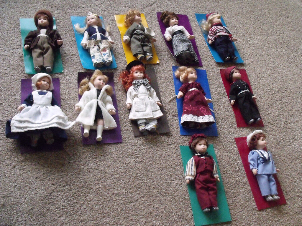 12 small dolls - brand new - possibly porcelain with moving arms /legs