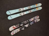 Two sets of junior twin tip skis