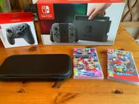 Nintendo Switch, 2 games, Pro Controller and carry case