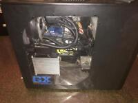 Custom gaming computer with monitor, keyboard and mouse