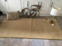 Gold rug , metal wall art, large lamp, cushions