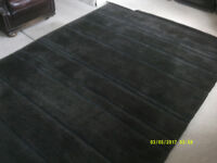 Large, beautiful pure new wool rug.