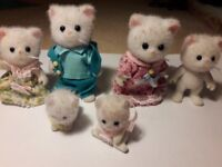 16 Sylvanian characters - various families and individual characters and beds