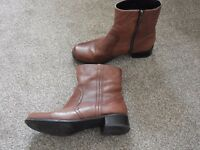 Brown short, flat boots. Size 6