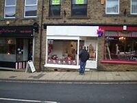 Town centre retail shop in Victoria Road, Elland, West Yorkshire in prime main road location.