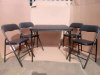 Brand new black quin table and 4 chairs RRP £100