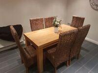 Solid oak table 6 wicker chairs