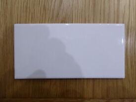 White ceramic 'Original Style Brand' wall tiles.