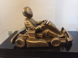 Vintage sculpture of go-kart racer