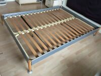 Double bed frame, kingsize, metal, with wooden legs. very nice condition