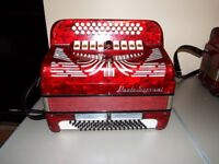 This is a very old Paolo Soprani BC C Sharp, this accordion has a stepped keyboard, great condition