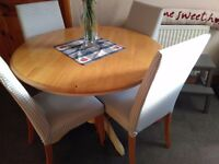 NEXT SET OF FOUR, HIGH BACKED PADDED DINING CHAIRS, WITH LIGHT OAK LEGS,