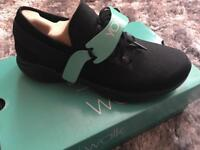 Brand new boxed size 4 black sketchers trainers