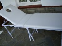 IN VERY GOOD CONDITION MASSAGE TABLE WITH HIGHT AJUSTABLE LEGS FOLDS FOR STORAGE ONLY £30