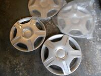 SELECTION OF WHEEL TRIMS.