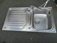 Kitchen sink with mixer taps, worktop and gas hob