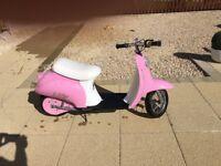 Razor mod kids electric Vespa sit on scooter in pink