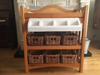 Solid wood baby changing unit complete with integrated bath and storage baskets