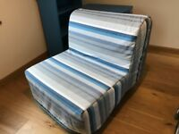 Ikea Lycksele single sofa bed futon with blue / grey striped cover and mattress.