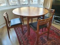 Mid century teak drop leaf dining table with 4 chairs in very good used condition