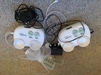 Two electric breast pumps. One manual breast pump.