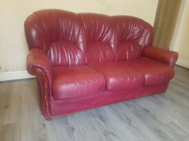2 single seaters and one 3 seater leather red sofa for sale