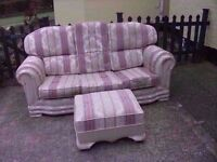 Fabric pattern 3 seater sofa and poufee Good condition Delivery Available £15