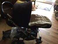 Bugaboo Cameleon buggy pram with accessories.