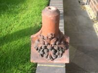 A Vicrorian/Edwardian red terracotta roof ridge finial.