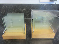 Two sets of beautiful qaulity designer glass coasters in lovely wooden racks