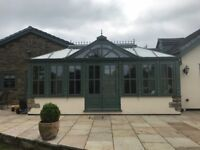 Stunning solid mahongany Conservatory with double glazed roof and fitted sun blinds.