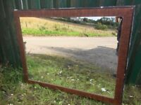 Large wall hanging mirror in a wooden frame
