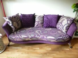 A three part suite comprising 4 seater sofa, 2 seater sofa and oval pouffe