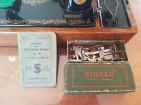 singer sewing machine in box with original paperwork and attachments