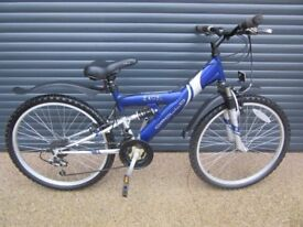 CHILDS APOLLO EXCEL SUSPENSION BIKE IN EXCELLENT LITTLE USED CONDITION.. (SUIT APPROX. AGE. 9+)..