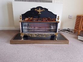 Attractive double bar fire decorative fire with stand if required.