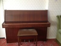 Modern upright piano. Superb condition.