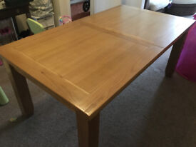 6 SEATER SOLID WOOD DINING TABLE - EXTENDS TO SEAT 8