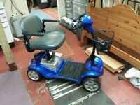 Kymco Mini LS ForU mobility scooter with charger, key, manual and wheelyscoot crutch bag