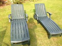2 lounger chairs