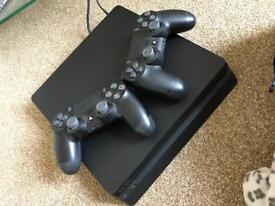 New PS4 Slim 500GB console with 2 wireless remotes