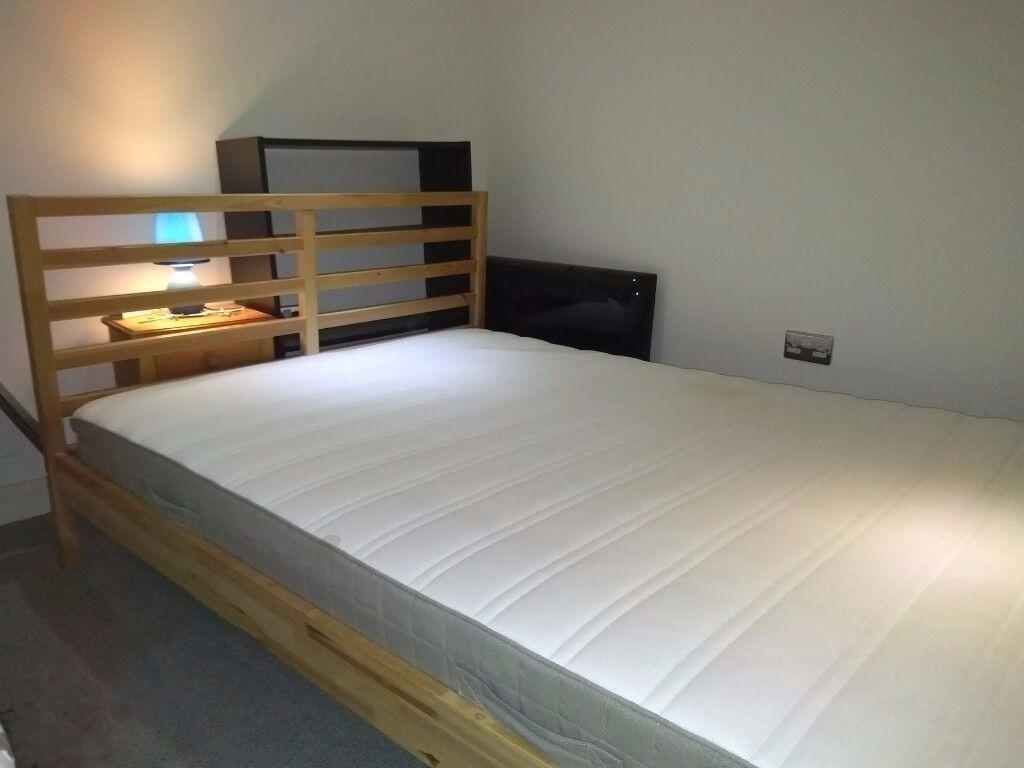 King-sized bed frame with matching mattress (IKEA Tarva + Hamarik)