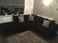 Black fabric left hand corner sofa & poof