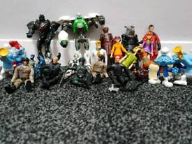 Mixed action figures includes Dr Who, Iron Man, Batman, Scooby Doo, Smurfs