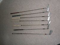 SEVEN VINTAGE GOLF CLUBS - SOLD AS FOUND